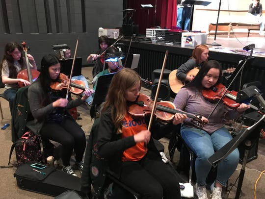 The orchestra pit handles the musical challenge of