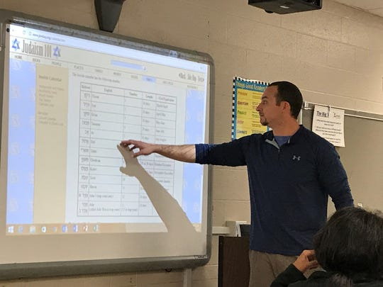 Liberty Tech teacher Scott Kee explains the differences between the Ceasarian and Hebrew calendars during Bible class on Thursday.