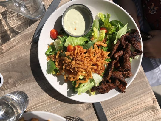 A seared beef salad at The Cafe at Ginger and Baker.