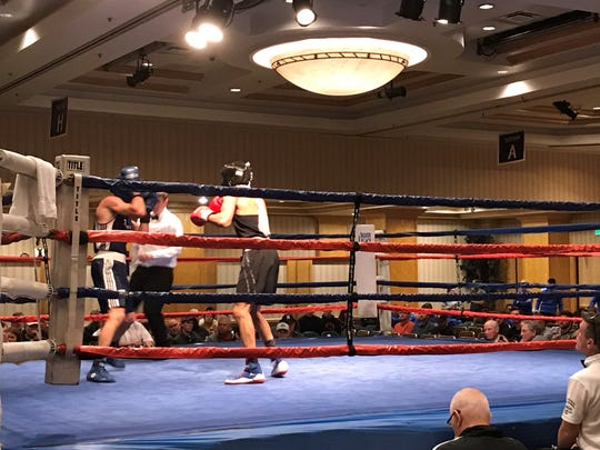 Nevada's Nate Strother boxes Levi Knox from Air Force Friday night at the Eldorado Resort Casino