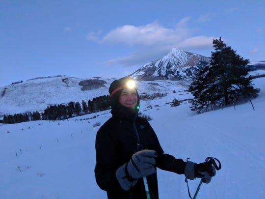 Aren Elliott trudges through the snow along a Nordic