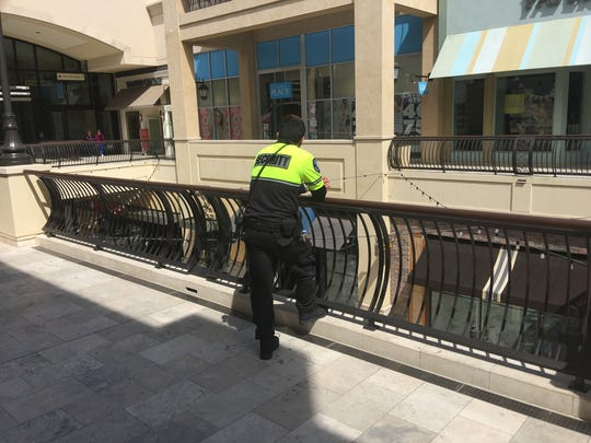 A private mall security guard could be seen Sunday across from the Paper Source stationery store in The Oaks mall in Thousand Oaks following a murder and attempted suicide in the store Saturday.