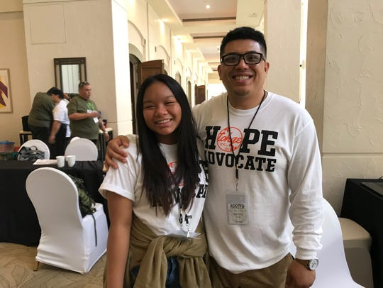 Amber Parado, 14, and Garrett Duenas attend the 2018