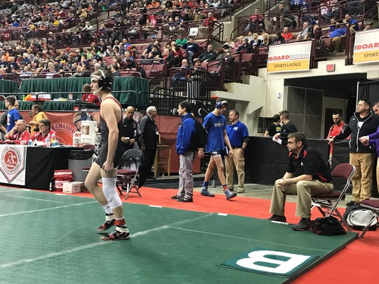 Marion Harding wrestler Mason Sparks gets ready for