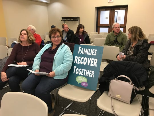 Families wait for the Greece Town Board meeting to
