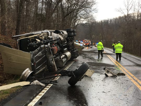 A tractor-trailer rig came to rest about 150 feet from