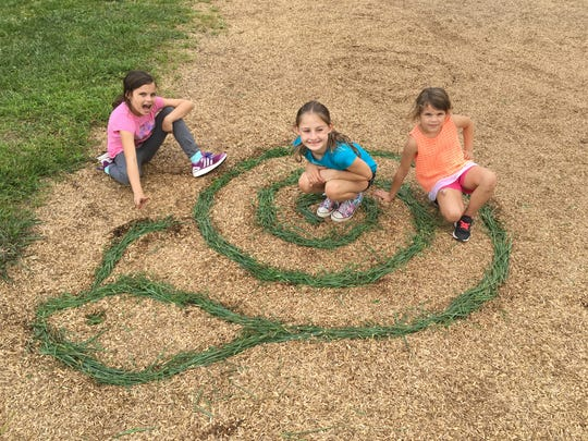 Grab some grass clippings and make a temporary piece of art right on the ground.