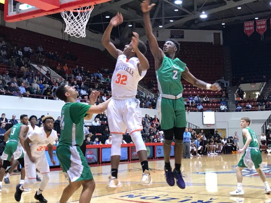 Belleville's Jalen Williams shoots over Novi's Traveon Maddox Jr. (2) in a Class A quarterfinal at Detroit Mercy's Calihan Hall on March 20, 2018.