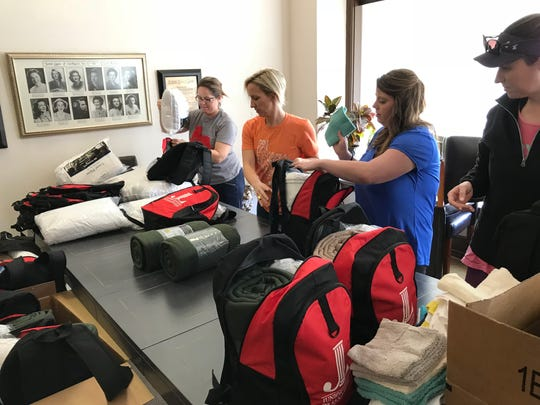 Members of the Junior League of San Angelo pack Hope Totes with items that will help children removed from abusive homes.