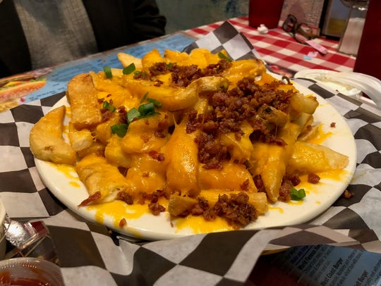 Cheese fries at Huey's, with bacon bits and green onions.