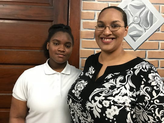 Jasmine Hightower, 12, (left) is a student at Davison