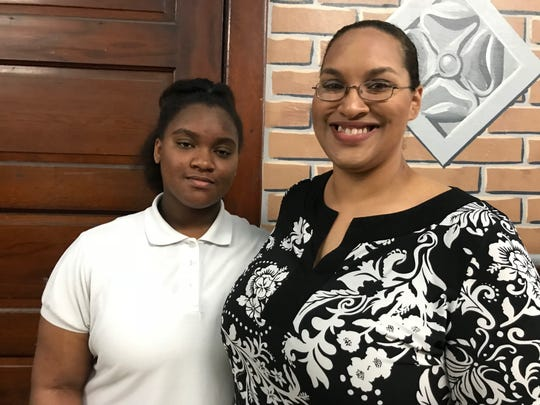 Jasmine Hightower, 12, (left) is a student at Davison Elementary-Middle School. She stands with her mom, Ann Hightower, 37. Their family participated in the Detroit school's Parent Teacher Home Visit Program and enjoyed the experience.