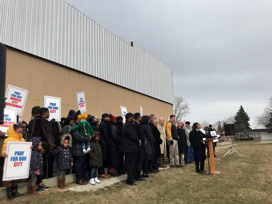 Members of the LAM Christian Church in Warren at a news conference today at which Bishop Adolphus Cast announces they won't fight a City Council vote ordering the demolition of an unfinished $1.2-million addition to the church.