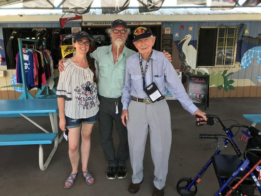 Navy Veteran Edmond Stearman, right, with his son Scott, center, and his granddaughter Layla Cotton, left, pose for photo. Military Veterans took a tour of historical landmarks on Guam before they embark for the 73rd anniversary of Iwo Jima Reunion of Honor tour on Iwo Jima island.