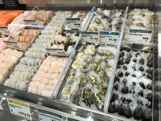 Oysters at the center of the seafood section at Whole