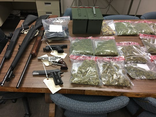 Drugs, guns and cash were seized.