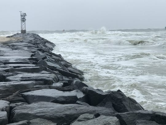 Waves crash into the Inlet in Ocean City as a nor'easter