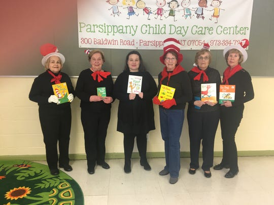 In celebration of Dr. Seuss' March birthday, members of the Woman's Club of Parsippany-Troy Hills read to the children at the Parsippany Child Day Care Center. WCPTH members donated a copy Dr. Seuss's The Foot Book to the Day Care Center Library and provided afternoon snacks to the children for a Dr. Seuss party. Pictured (from left to right) are Woman's Club of Parsippany-Troy member Cathy Haney and Marilyn Zarzycki, WCPTH Dr. Seuss Reading Project Chairman, help present Parsippany Child Day Care Center Director Peggy Rauscher, with a copy of The Foot Book. Also pictured are club members Janet Reilly, Lois Brown and MaryAnn Coyne.