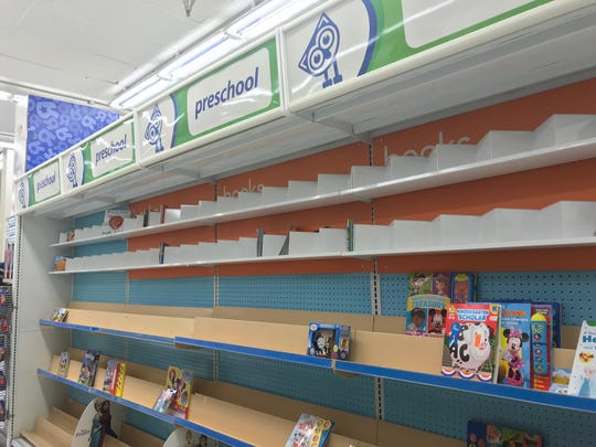 A mostly empty book display at the Toys R Us store