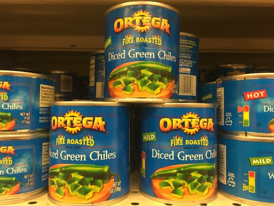 Cans of Ortega fire-roasted chilies are seen on a grocery