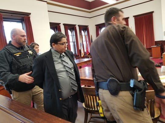 Deputies handcuffed and led David Dean Komeotis from the courtroom on Wednesday after the jury delivered a guilty verdict in his case.
