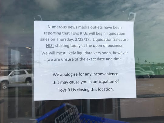 A sign outside Toys R Us in Corpus Christi tells shoppers its liquidation will be postponed. Its among the hundreds of stores nationwide that was expected to close this week.