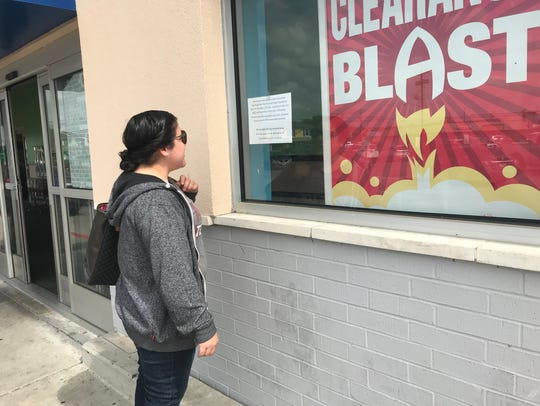 Alice resident Jennifer Lopez, 28, reads a sign posted