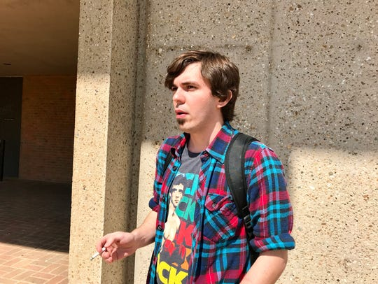 Joseph Hill, 22, a junior at UT Knoxville, smokes a