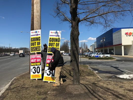 Highway sign walkers took their positions Friday to