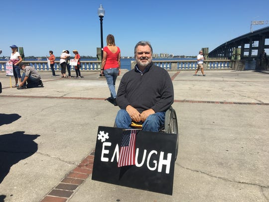 Jim Kelley, 57, has a sign that reads #enough on March
