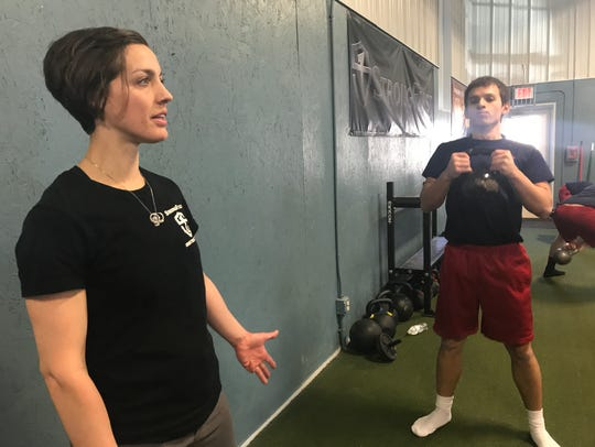 Victor Kettlebell & MMA co-owner Kerry Davis instructs