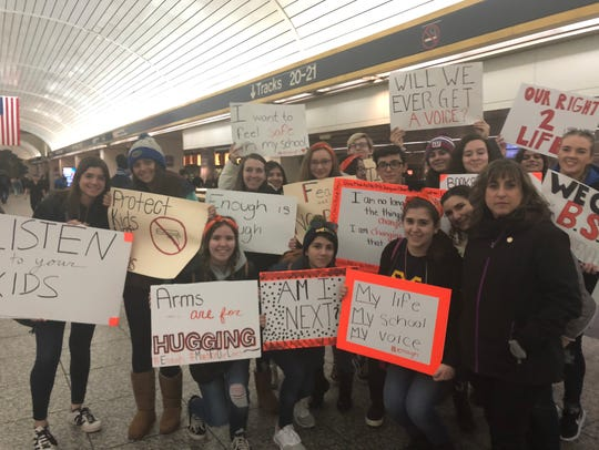 New York State Assemblywoman Christine Pellegrino, right, marched Saturday with a group of students from Massapequa High School on Long Island.