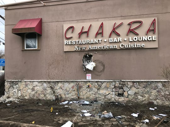 Damage to Chakra Restaurant in Paramus is visible on Sunday, March 25, 2018, a day after three vehicles crashed into the side of the building.