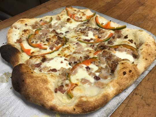 A clam pizza will be on the menu at the new location