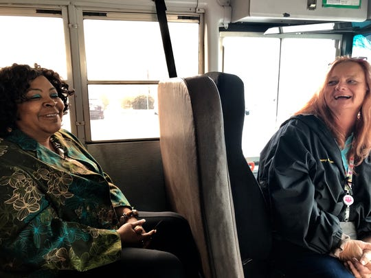 Brenda Copeland, left, and Tammy Cummings share a laugh as they recall their school bus accidents last week.