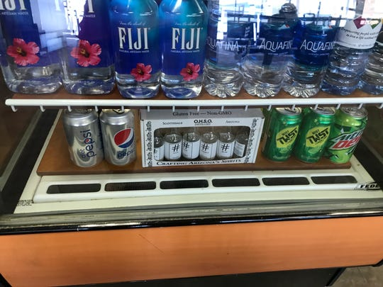 The OHSO Brewery & Distillery at Terminal 2 at Sky Harbor International Airport sells mini-bottles of liquor and growlers of beer to go.