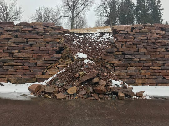 A collapsed portion of a quartzite wall at Sherman Park that has closed down Indian Mound Place west of Kiwanis Avenue