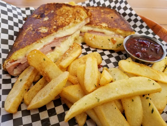 The Monte Cristo Sandwich ($9), made with fried ham and Swiss cheese between two slices of French toast.