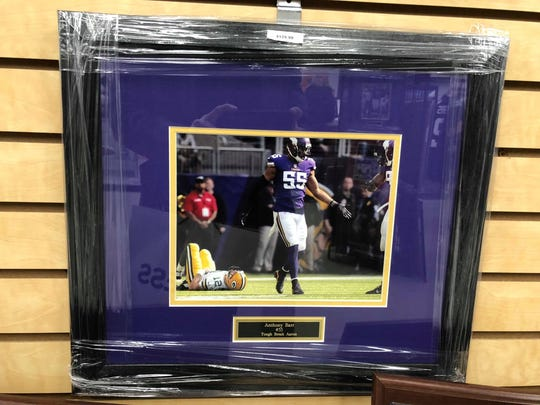 This image of Packers quarterback Aaron Rodgers and Vikings linebacker Anthony Barr is listed for $129.99.