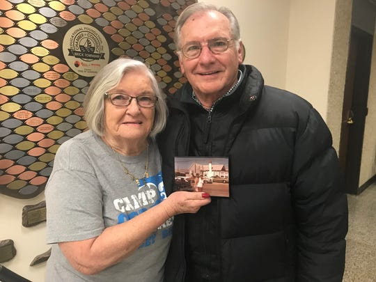 In 2018, June Squillaro and brother Robert Taylor hold a picture of their parents in Camp Osborn.