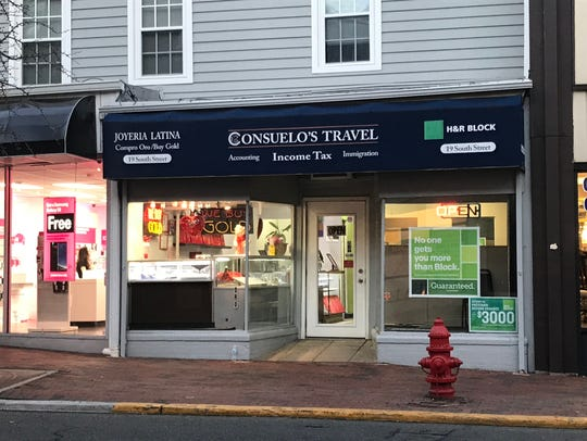 Consuelo's Travel in Freehold Borough advertises immigration