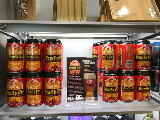 SanTan Brewing Co.'s Devil's Pale Ale is among the new souvenirs available at the AZCentral.com store in Terminal 4 at Phoenix  Sky Harbor International Airport