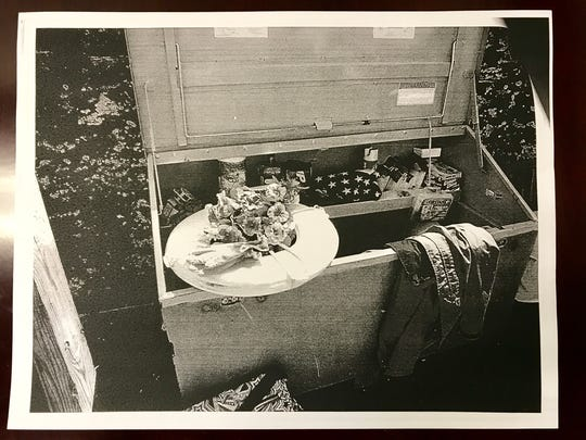 This picture shows a black and white copy of one of the photos submitted as evidence for the Angelika Graswald murder case. The photos were taken by state police on April 29, 2015 at Bannerman Island. This particular photo depicts a wreath of flowers Graswald told police she planned to lay out for Vincent Viafore.