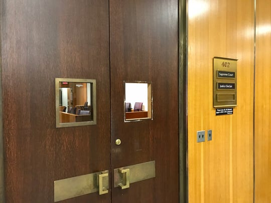 The brother of a convicted murderer punched through a door window of a courtroom in the Hall of Justice on March 27, 2018.