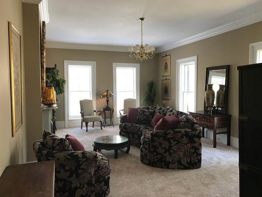 The stately living room of the historic brick estate