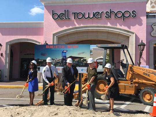 Dignitaries participate in a ceremonial groundbreaking Tuesday at the Bell Tower Shops in south Fort Myers.