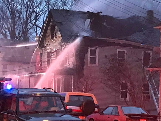 A two-alarm fire heavily damaged an Arlington Avenue