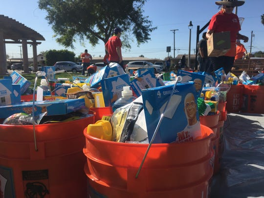 Buckets of cleaning supplies dedicated to veterans