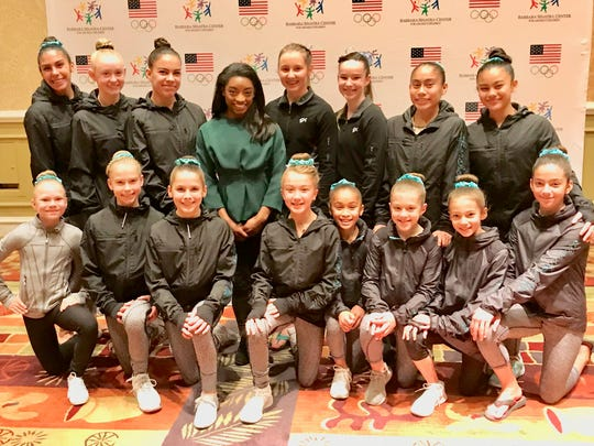 Honoree Simone Biles poses with members of Palm Desert's Aftershocks Gymnastic Team which escorted her into the event to a standing ovation.