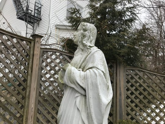 Saint John's hands are snapped off a statue at Our Lady of the Lake Church in Verona. Police are investigating vandalism to three statues on the property.